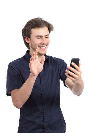 Happy man waving to a smart phone camera isolated on a white background photo