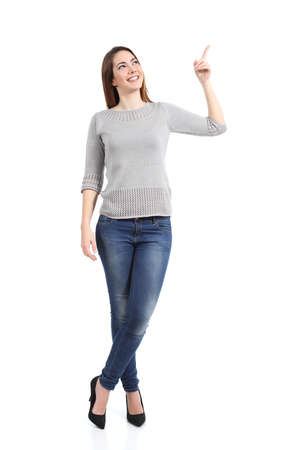 woman standing: Full body of a standing casual woman pointing at side isolated on a white
