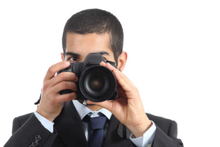taking photograph: Front view of a professional photographer taking a photograph isolated on a white background