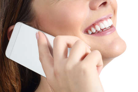 Close up of a woman smiling and calling on the mobile phone isolated on a white background photo