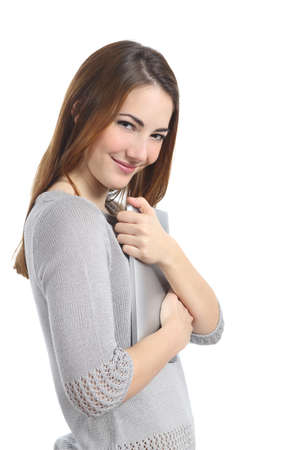 possession: Pretty possessive woman hugging a tablet isolated on a white background Stock Photo