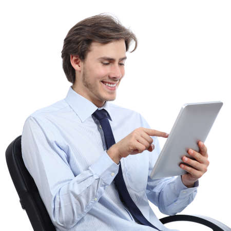 office use: Executive sitting on a chair browsing a tablet isolated on a white