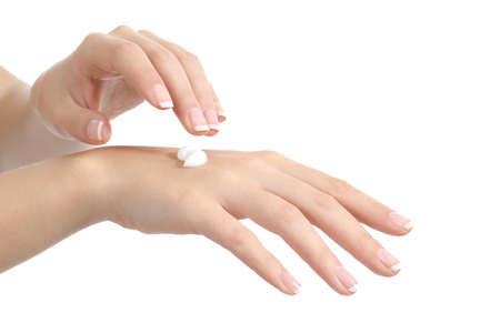 Woman hands with perfect manicure applying moisturizer cream isolated on a white background