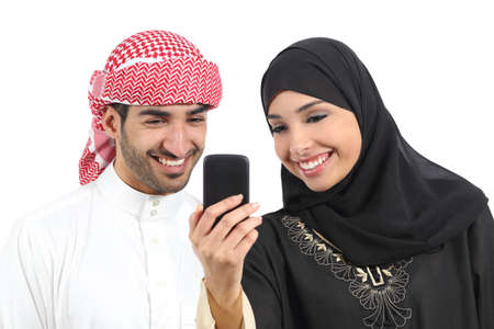 Arab couple sharing social media on the smart phone isolated on a white background             photo