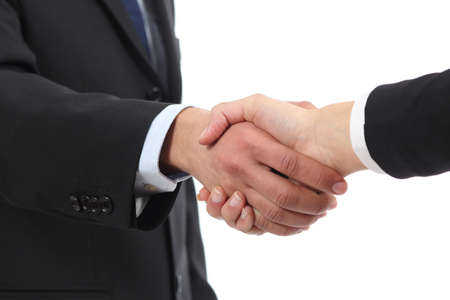 promoter: Closeup of a businessman and woman hands handshaking isolated on a white background Stock Photo