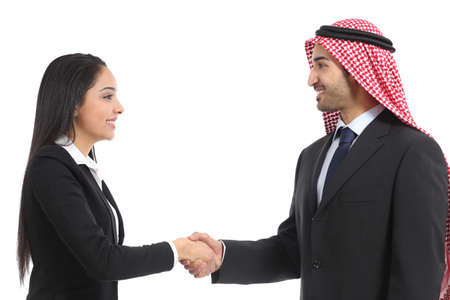Side view of an arab saudi businesspeople handshaking isolated on a white background                photo