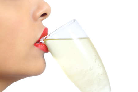 year profile: Close up profile of a woman lips with red lipstick drinking champagne isolated on a white background