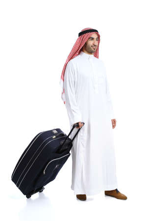 Arab traveler saudi man carrying a suitcase isolated on a white background