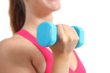 Close up of a fitness woman lifting weights exercising aerobic isolated on a white background photo