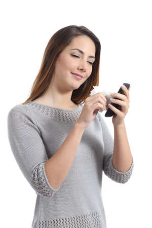 wipe: Pretty woman cleaning her smart phone screen isolated on a white background         Stock Photo