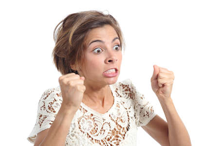 clenching teeth: Angry crazy woman with rage expression isolated on a white background