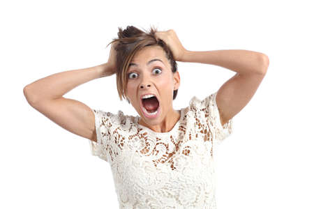 woman open mouth: Front view of a scared woman screaming with hands on head isolated on a white background