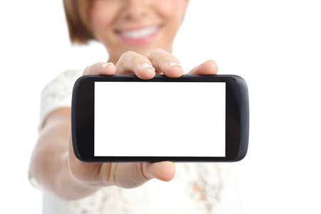 Closeup of a girl hand showing a horizontal blank smartphone screen isolated on a white background photo
