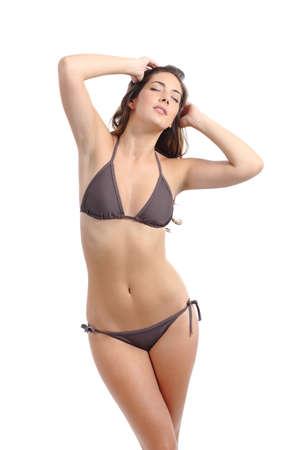 Perfect model woman fitness slim body posing wearing bikini isolated on a white background photo