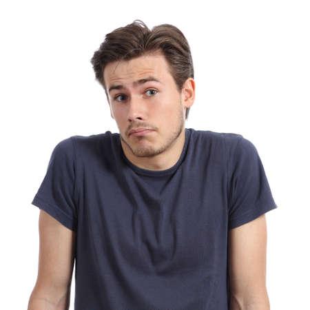 preguntando: Retrato frontal de un hombre joven dudando hombros shrugging aislado en un fondo blanco Foto de archivo