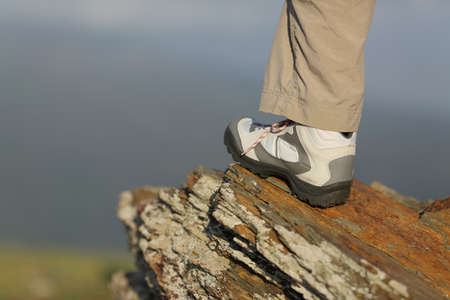 Hiker boot in the mountain with an unfocused background photo