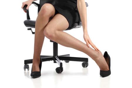 piernas con tacones: Mujer de negocios pies tocar con la mano aisladas sobre un fondo blanco Foto de archivo