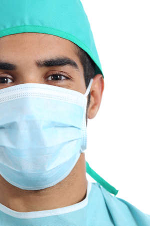 Portrait of an arab surgeon doctor face with mask isolated on a white background photo