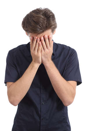bashfulness: Ashamed or worried man covering face with his hands isolated on a white background Stock Photo