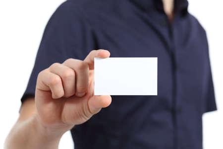 白い背景の上、空白の名刺を持っている人間手のクローズ アップ