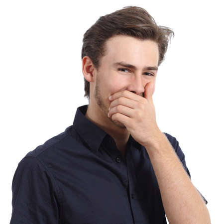 hide: Handsome man laughing while covering his mouth with a hand isolated on a white background Stock Photo