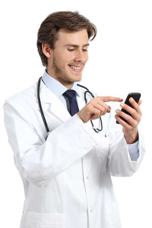 Happy doctor man texting on a smart phone isolated on a white background photo