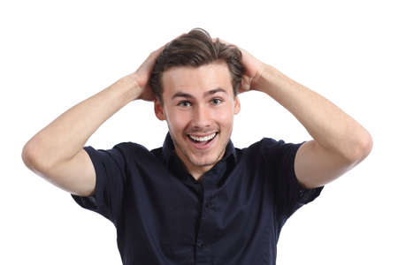 Surprised happy man smiling with hands on head isolated on a white background
