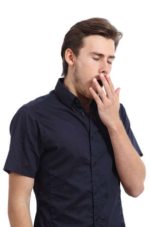 tired: Tired man covering his mouth white yawning isolated on a white background