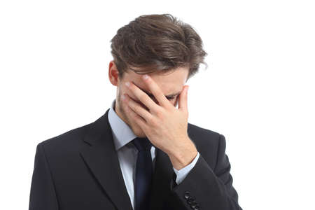 Worried or ashamed man covering his face with hand isolated on a white background photo