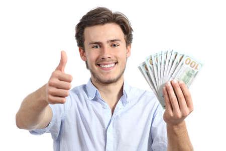 Jonge man bedrijf geld met thumbs up op een witte achtergrond Stockfoto