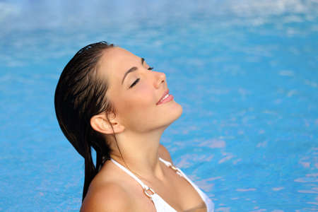 woman bathing: Beauty woman breathing deep fresh air while is bathing in the water of a pool in summer Stock Photo