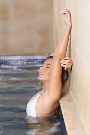 armpit hair: Beauty woman bathing in a spa posing showing her laser hair removal armpit Stock Photo