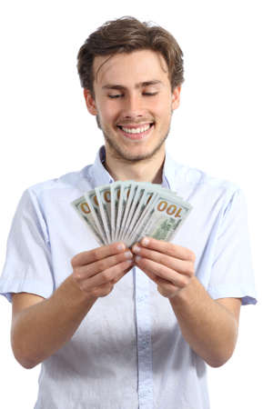 Casual happy man holding money isolated on a white background photo