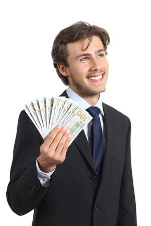 Happy businessman holding money and looking sideways isolated on a white background photo