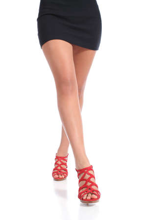waxed: Beauty waxed woman legs walking wearing heels isolated on a white background Stock Photo