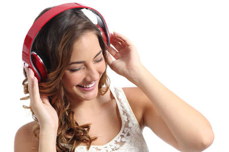 Young happy woman enjoying listening to the music from headphones isolated on a white background photo