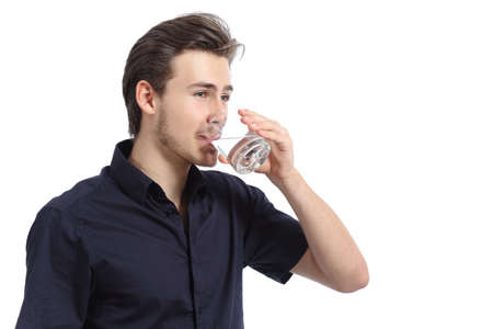 man drinking water: Attractive happy man drinking water from a glass isolated on a white background Stock Photo