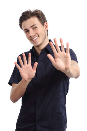 rejecting: Happy man rejecting and gesturing stop with hands isolated on a white background