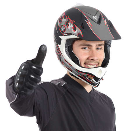Happy motor biker man gesturing thumbs up isolated on a white background