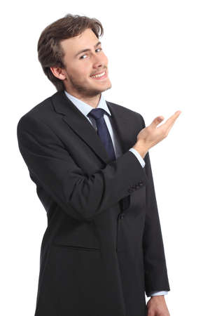 Young businessman presenting a blank promotion isolated on a white background