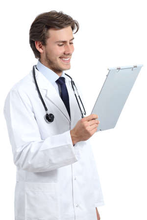 medical history: Young happy doctor man reading a medical history isolated on a white background
