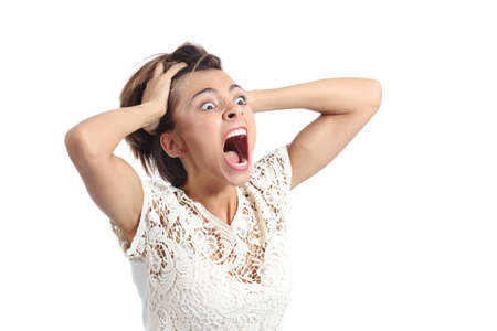 shout: Scared crazy woman crying with hands on head isolated on a white background