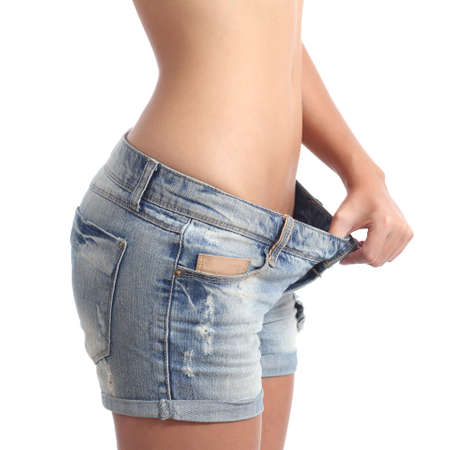 girl belly: Closeup of a woman waist weight loss diet concept isolated on a white background Stock Photo