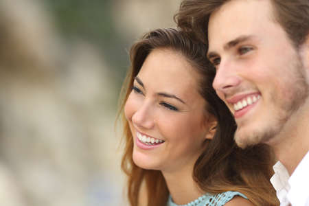 up to date: Happy couple in love looking away together with an unfocused background Stock Photo