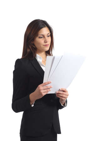 file clerks: Serious business woman reading a report isolated on a white background