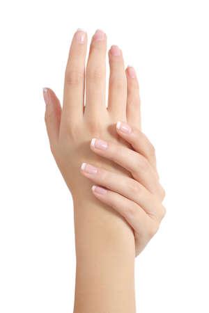 Mujer de la belleza manos con perfecto francés manicura aislada en un fondo blanco