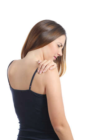 grabbing back: Casual woman suffering shoulder pain isolated on a white background