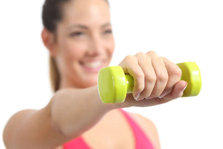 Closeup of a fitness woman exercising doing weights isolated on a white background photo