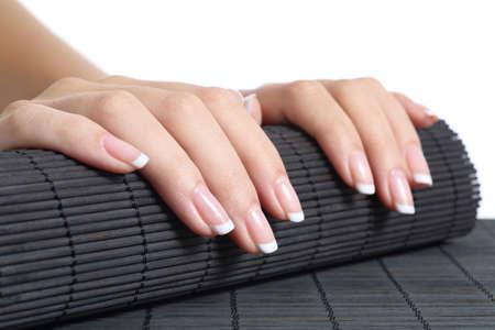 Vrouw handen met french manicure klaar voor een behandeling geïsoleerd op een witte achtergrond