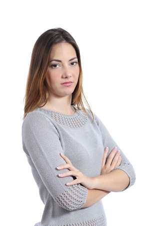 Woman posing disgusted with folded arms isolated on a white background